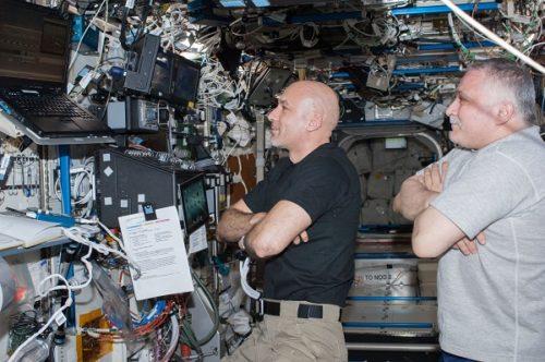 astronauts folding arms